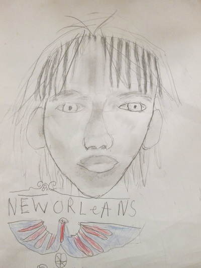 sixth grade analyzed their facial proportions from either a photograph or real life after adding value they filled the space around themselves with